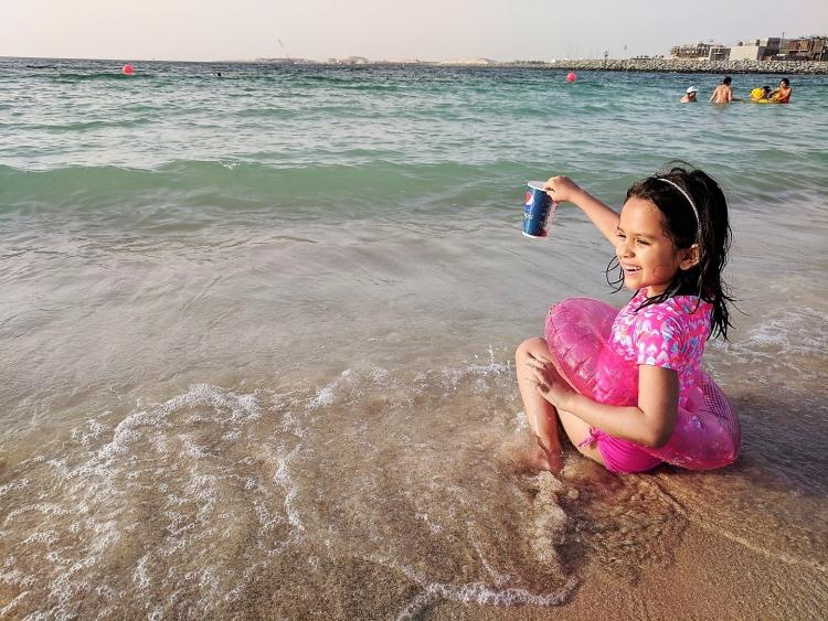 Dubai beach with kids. Bikinis Dubai