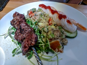 Fiddleheads Beef Brochette with couscous and shrimp cocktail