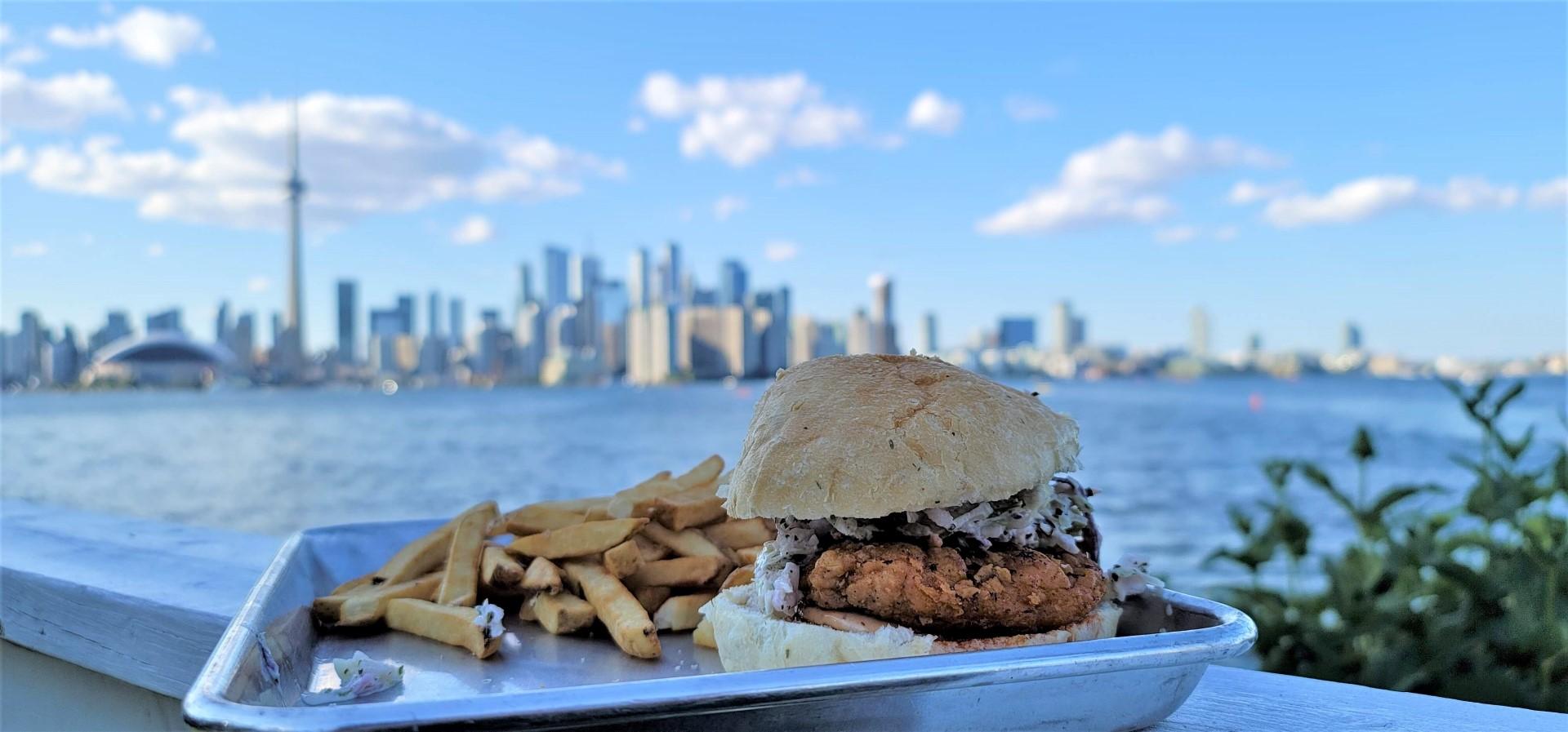 chicken sandwich with Toronto city views from Toronto Islands