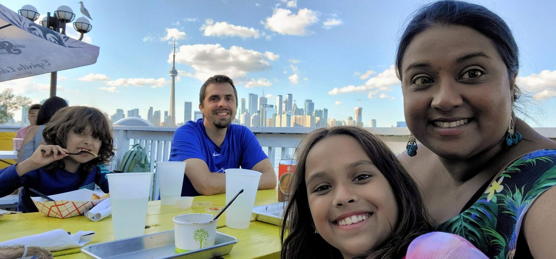Toronto family enjoying patio views from Toronto Islands