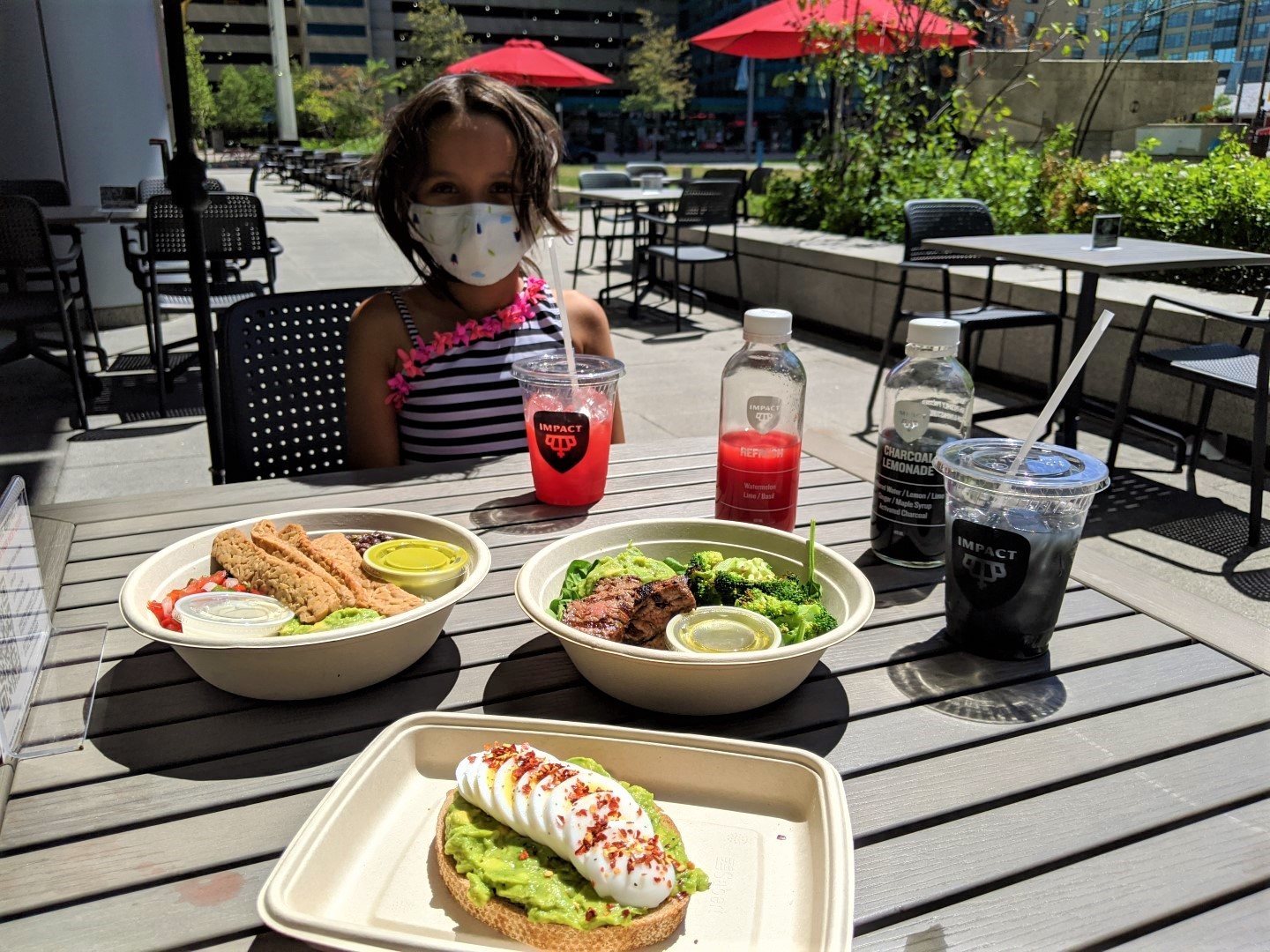 masked girl with healthy food at patio