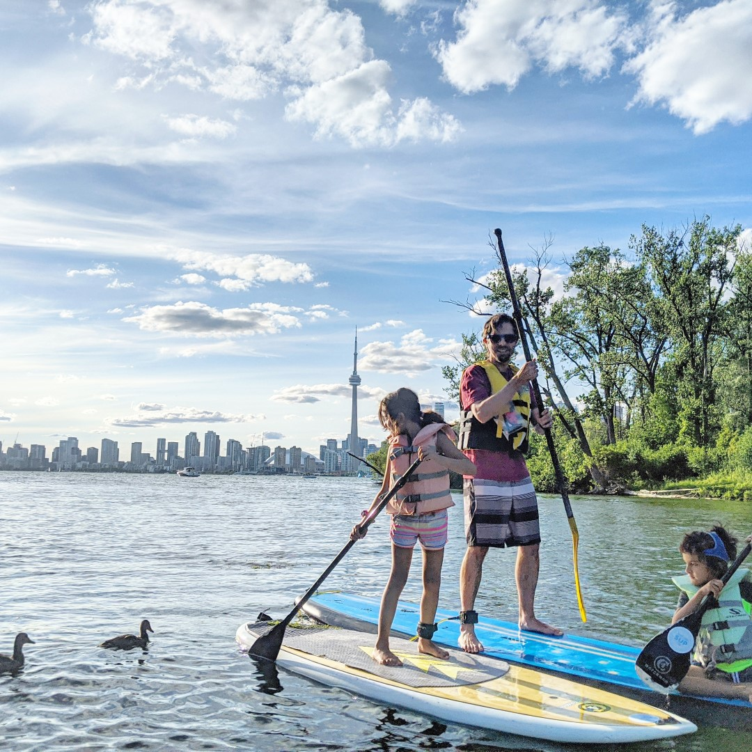 kids and dad on SUP in Toronto