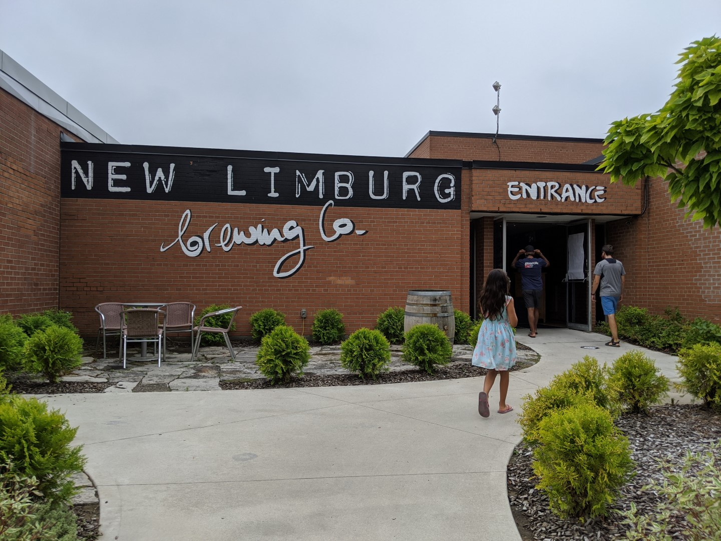 girl walking into new limburg brewery on ontario cottage weekend