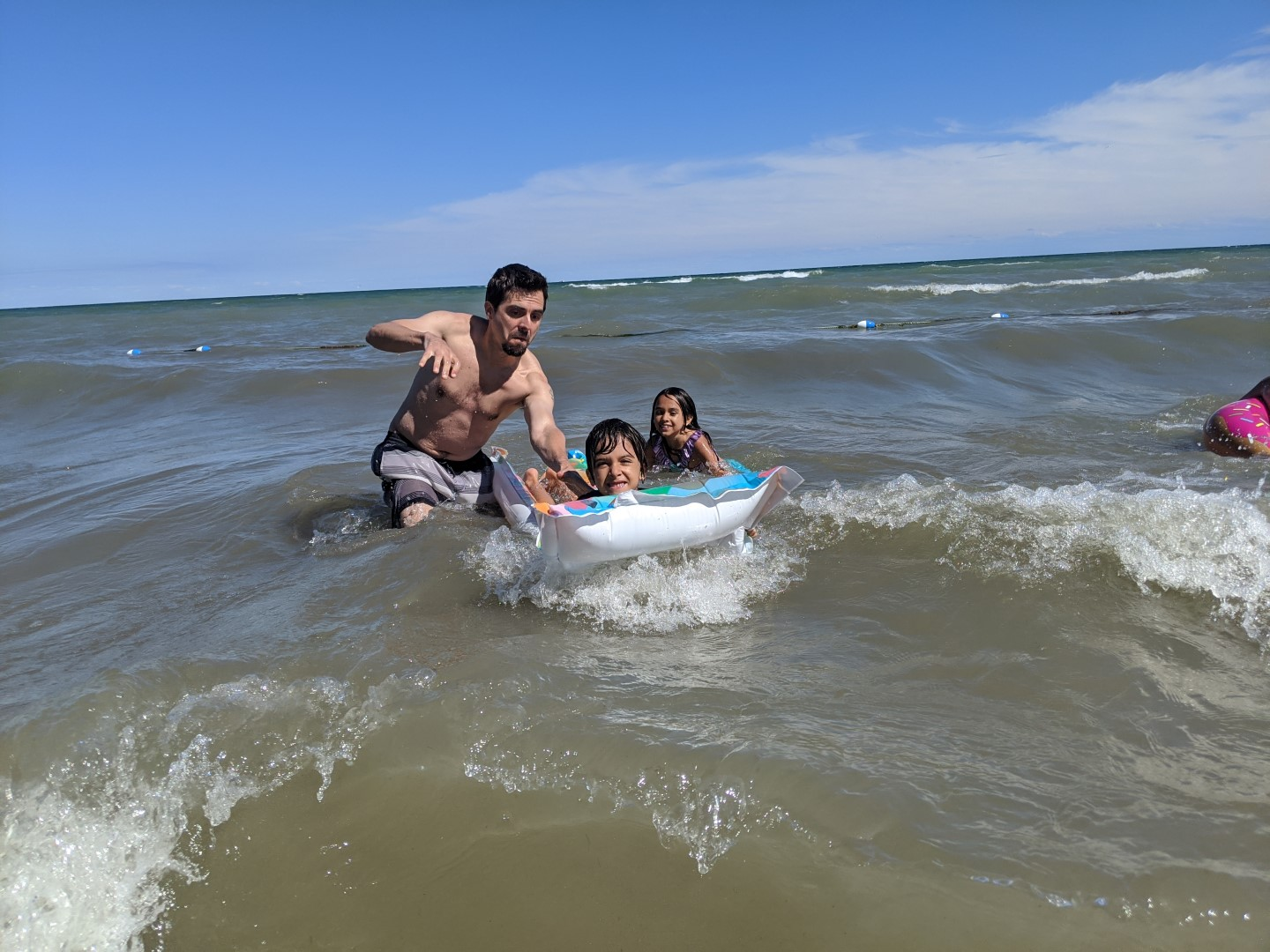 dad and kids at Turkey Point Beach in Ontario