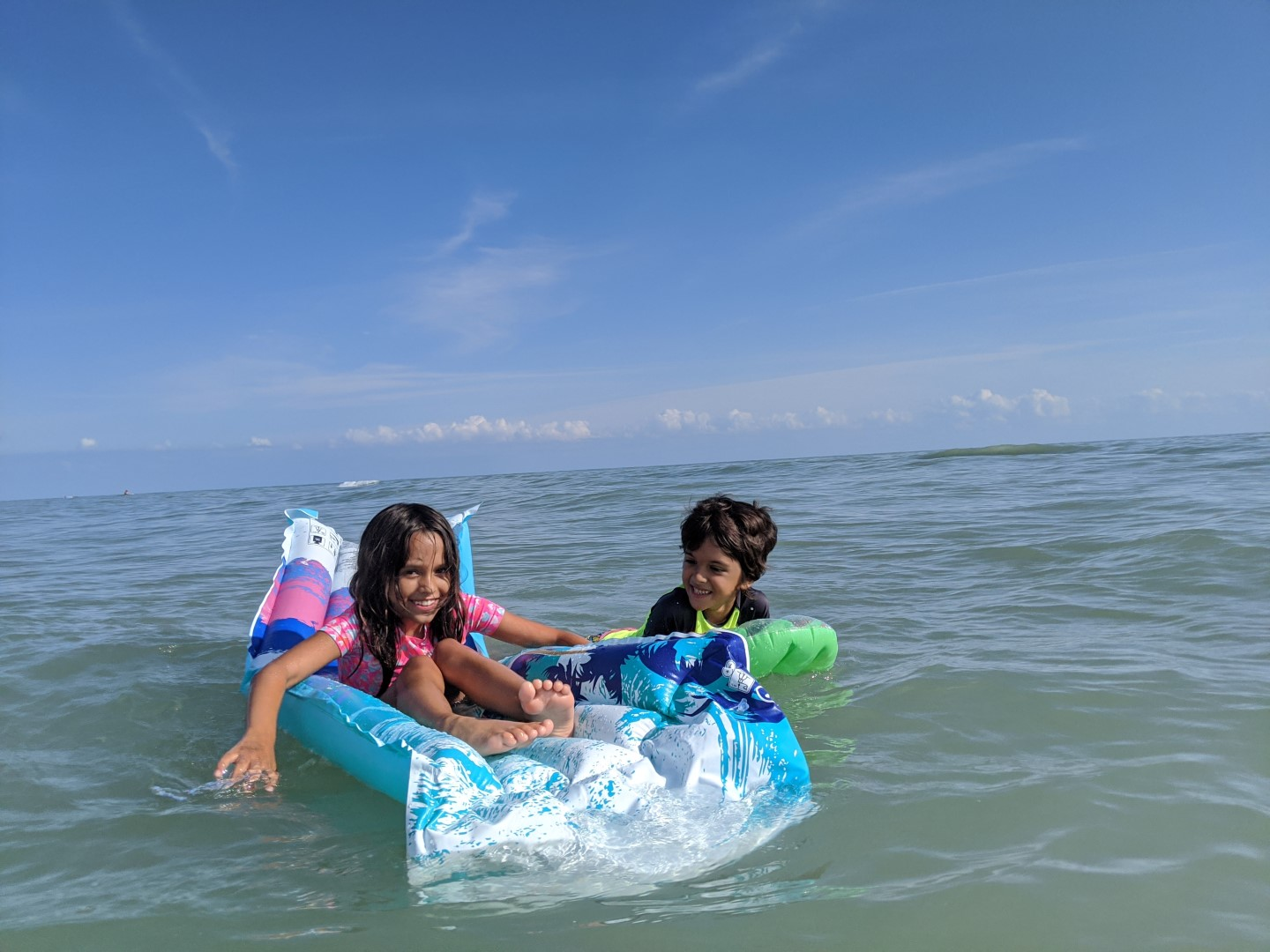 kids on floaties at Long Point Provincial Park