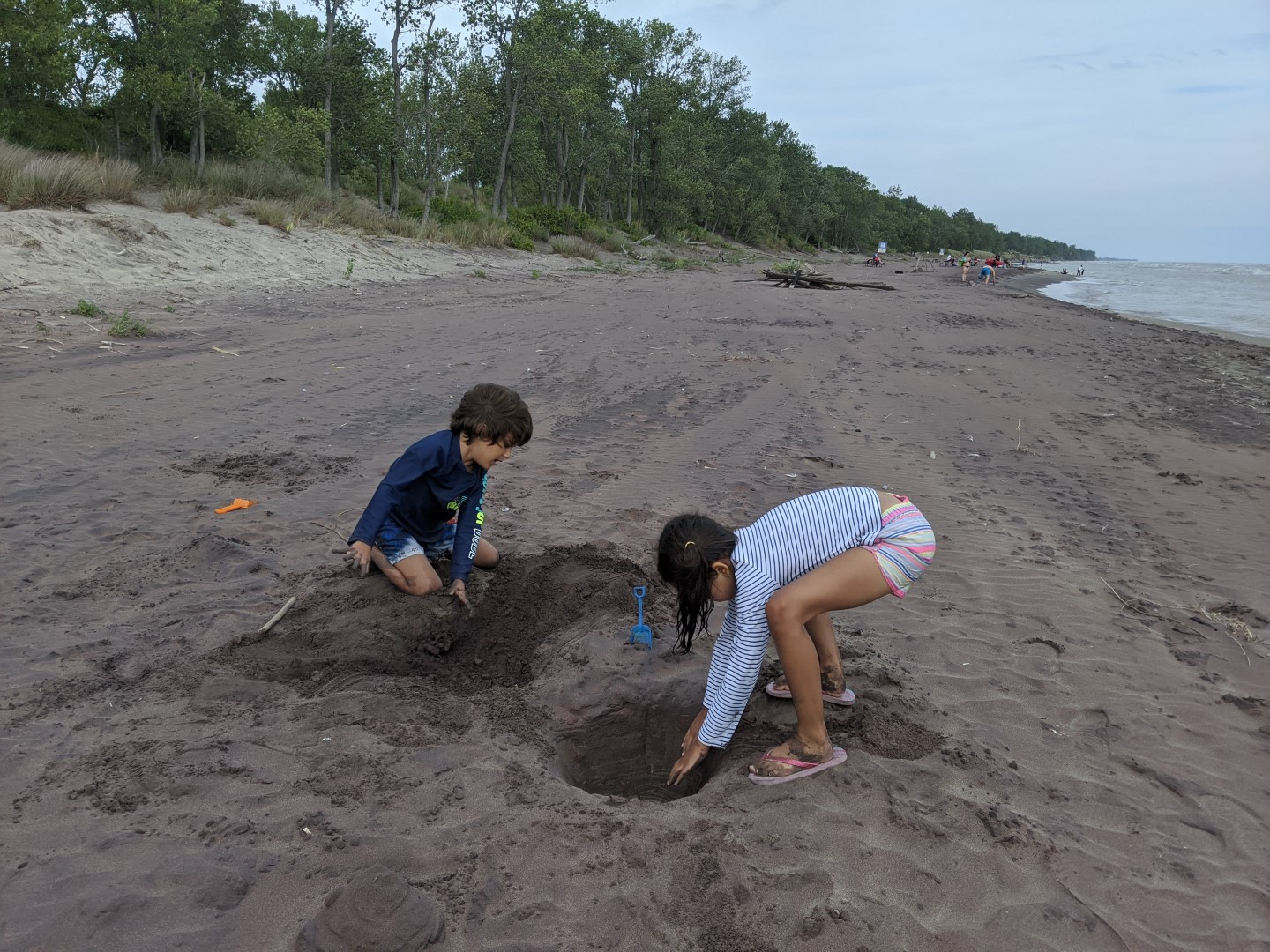 kids playing in sand at Long Point Provincial Park