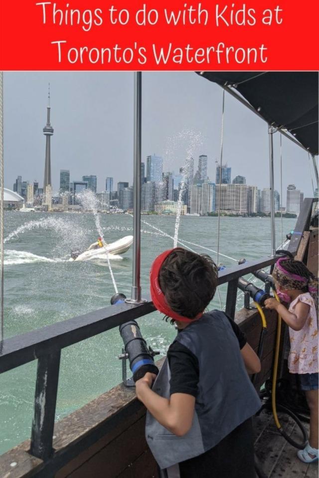 kids splashing pirate in water with cn tower