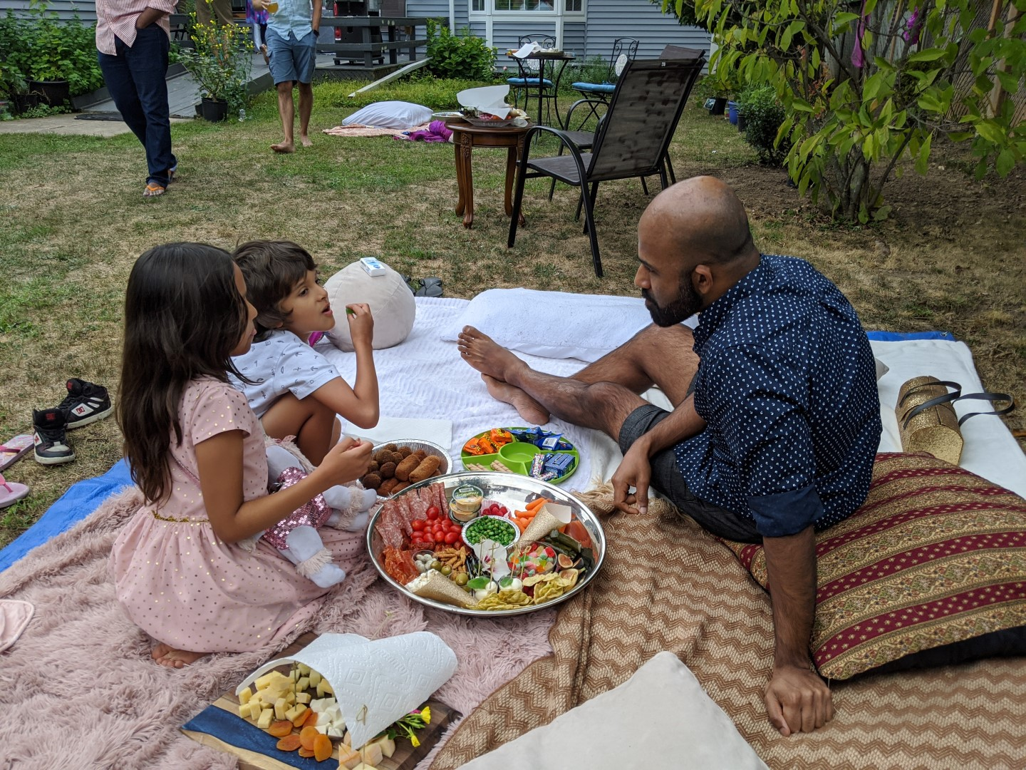 kids enjoying garden party picnic with uncle