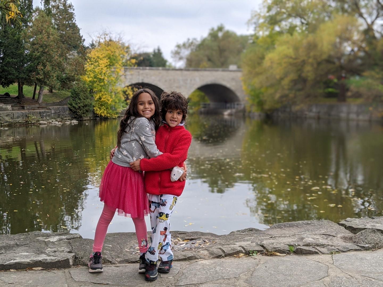 kids dressed in red in front of Stratford Ontario bridge