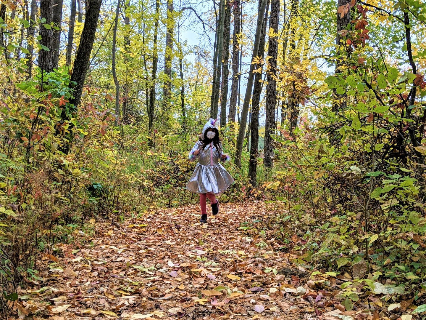 masked girl running through woods in Fall Stratford Ontario Forrest