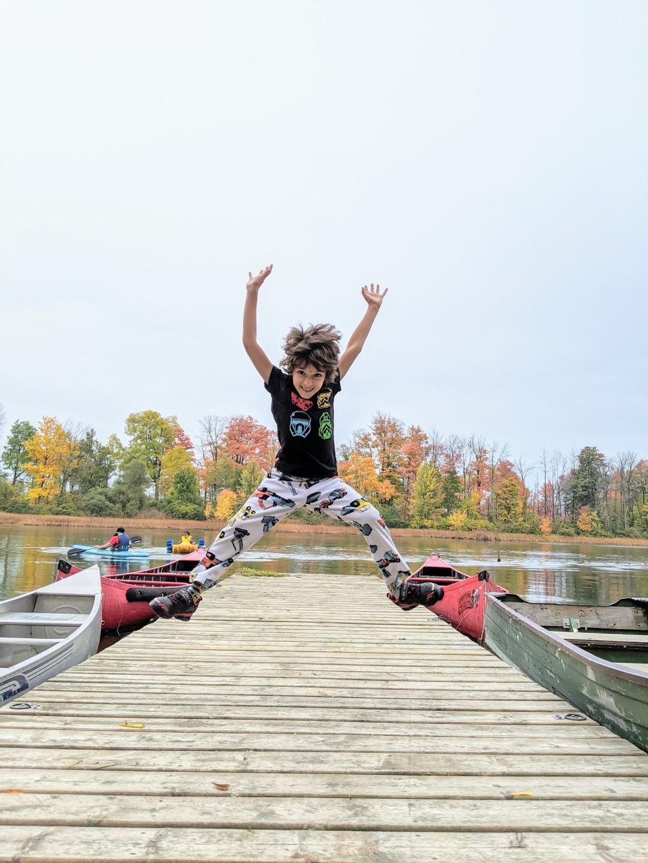 boy jumping on Forrest Motel boardwalk