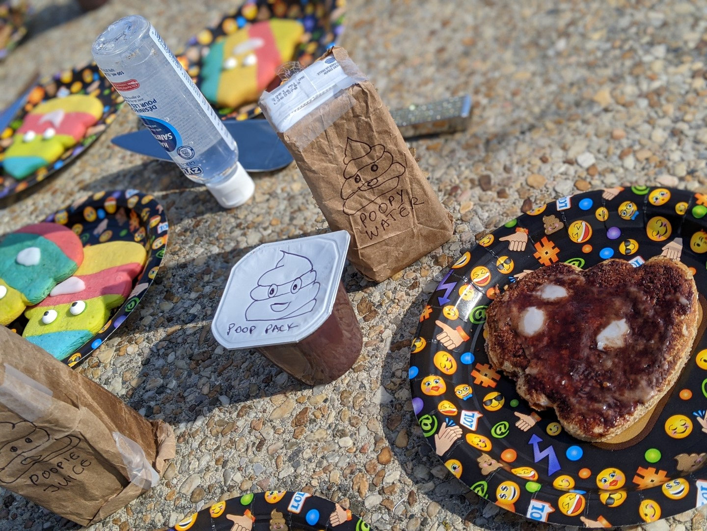 poop emoji drink and food on table