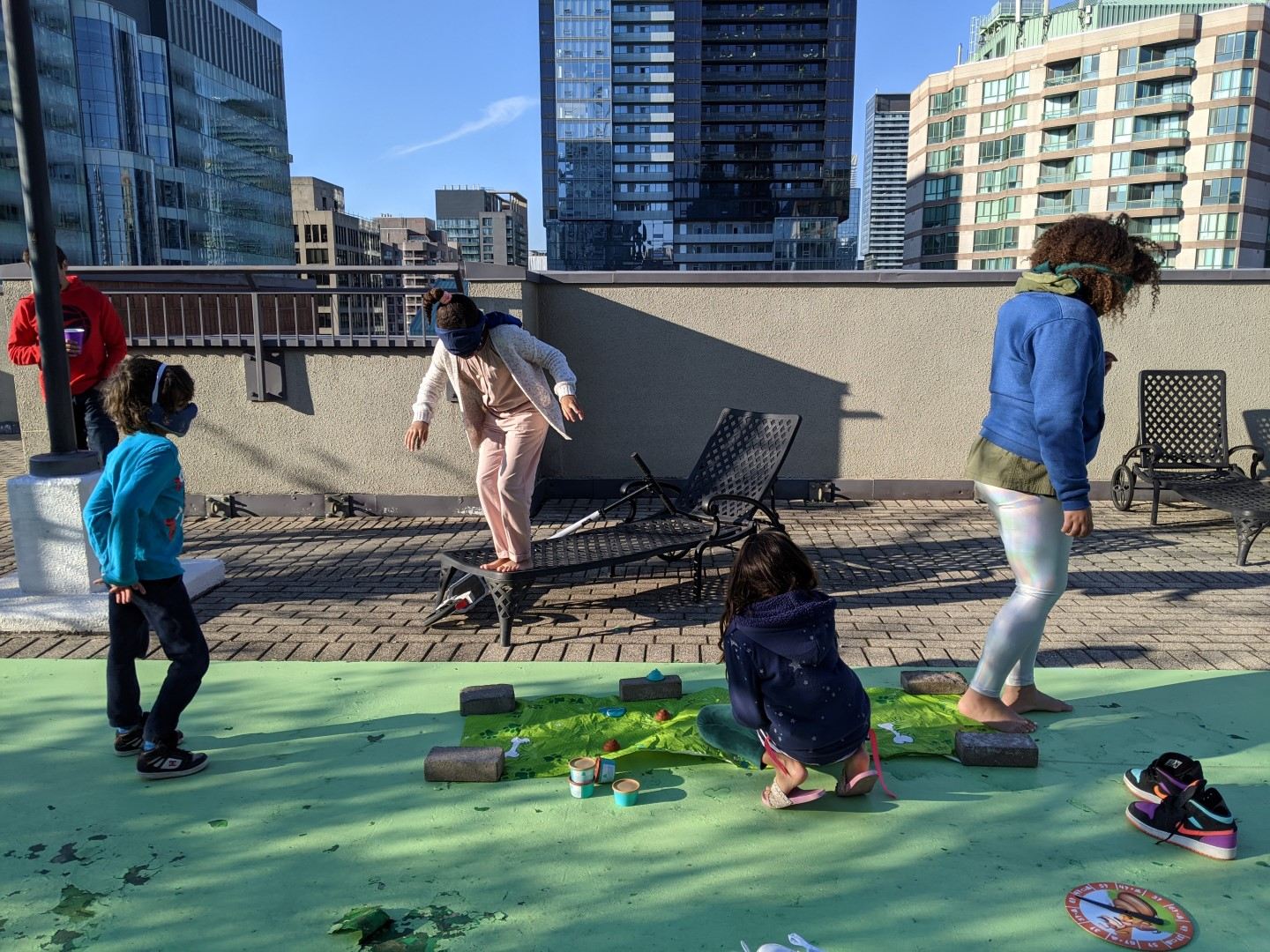 kids playing poop birthday game on Toronto rooftop birthday party