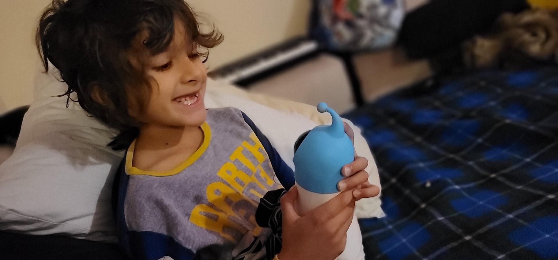 boy smiling at Roybi Robot Review