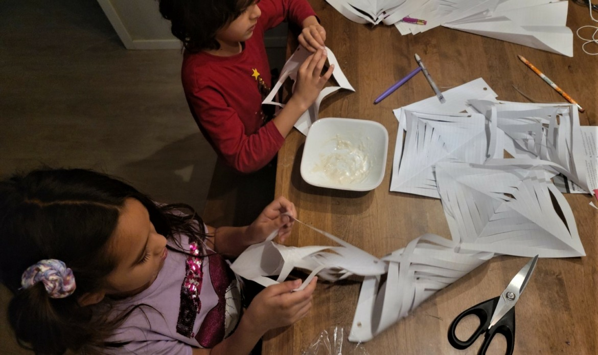 kids doing snowflake crafts in isolation