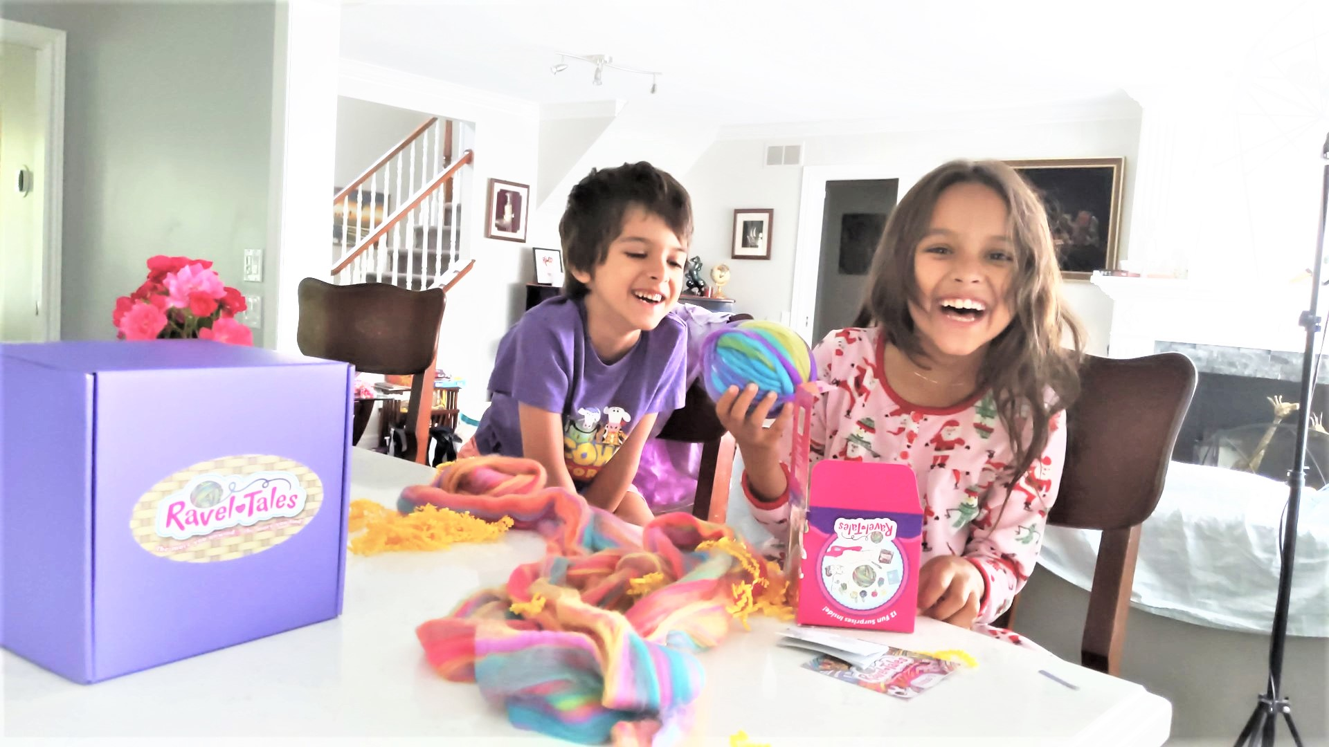 Girl and boy laughing at Ravel Tales toys for kids under 10 years of age