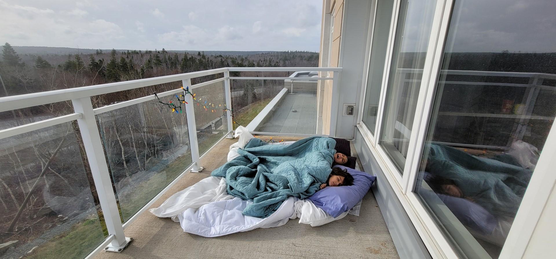 kids on balcony in Halifax winter
