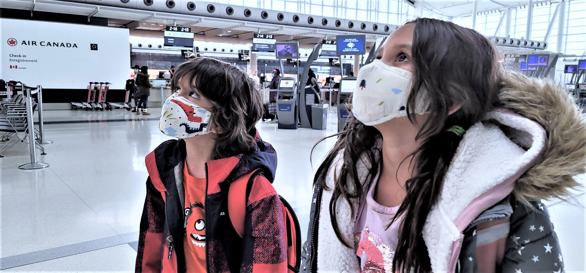 Kids at Toronto Pearson airport during COVID