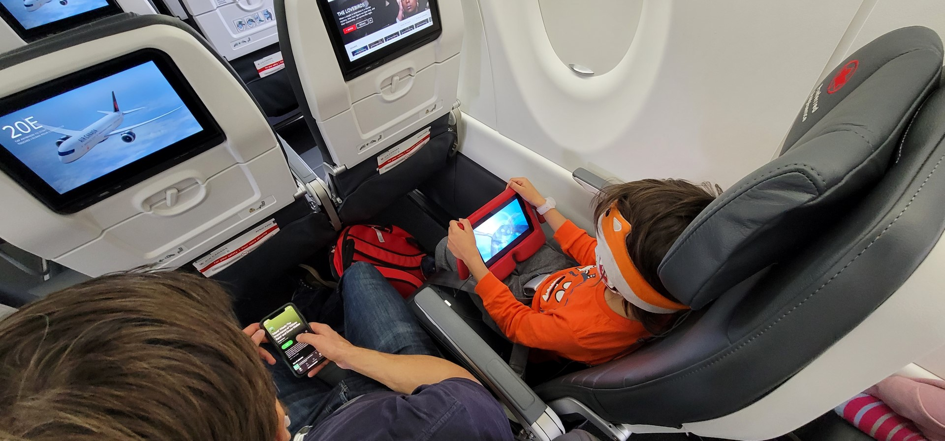 father son on screens during air canada flight