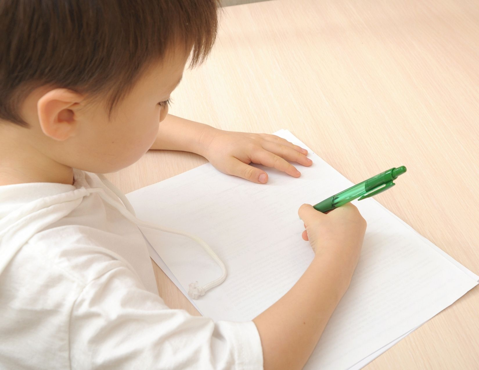 boy writing chore list