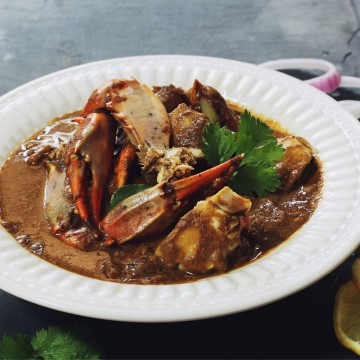 crab curry on white plate