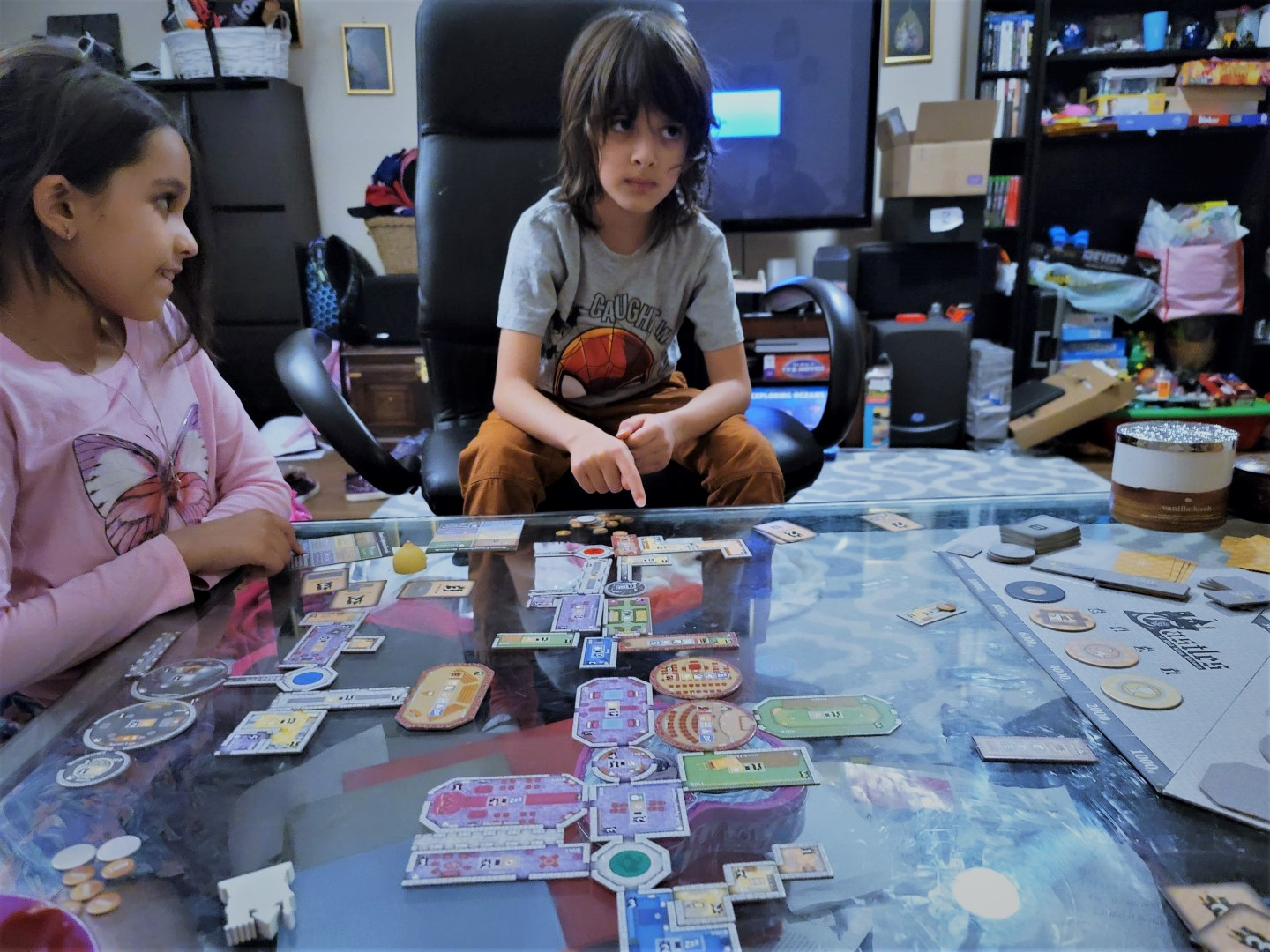 kids playing intense strategy board game castles