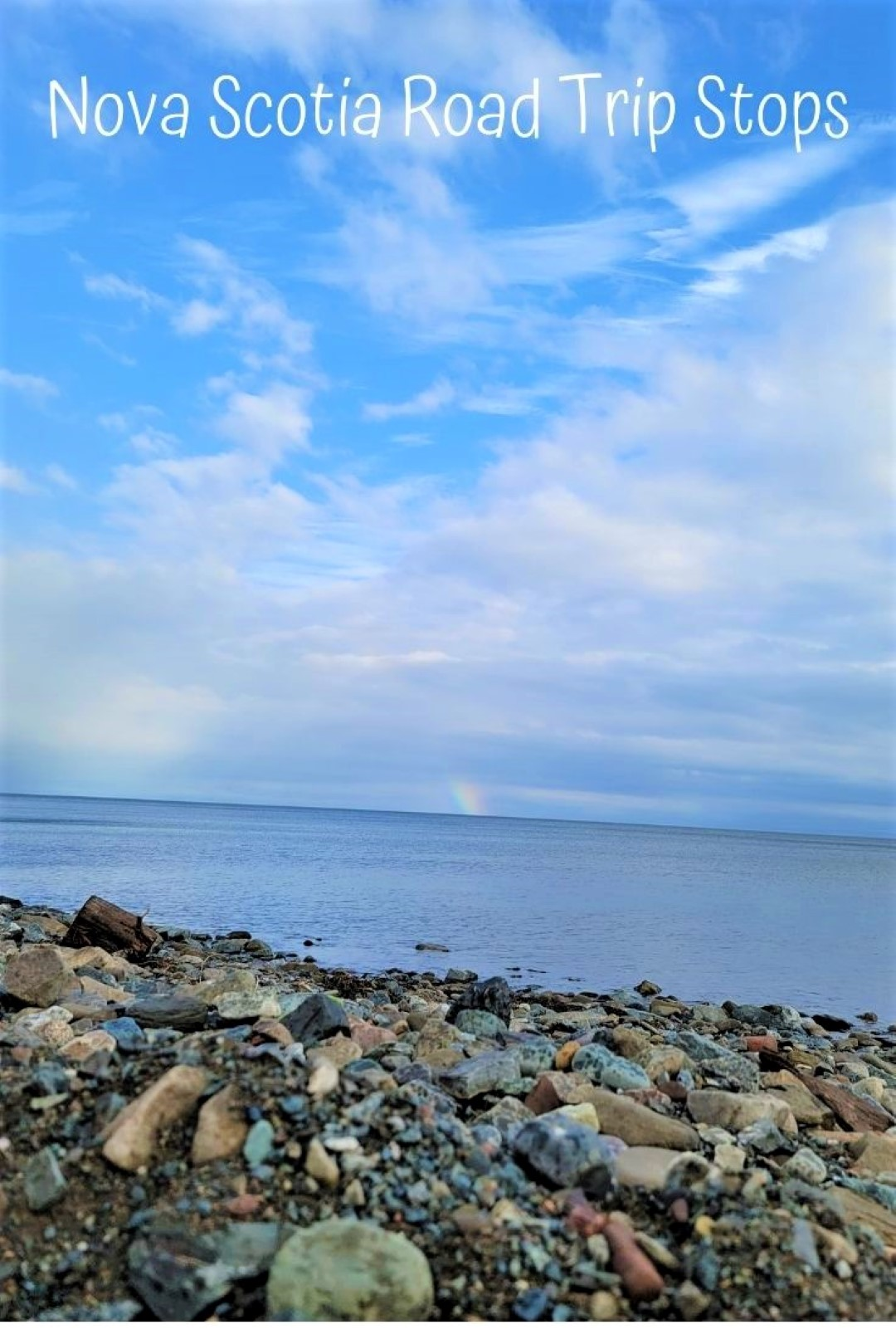 Beach with rainbow in Nova Scotia