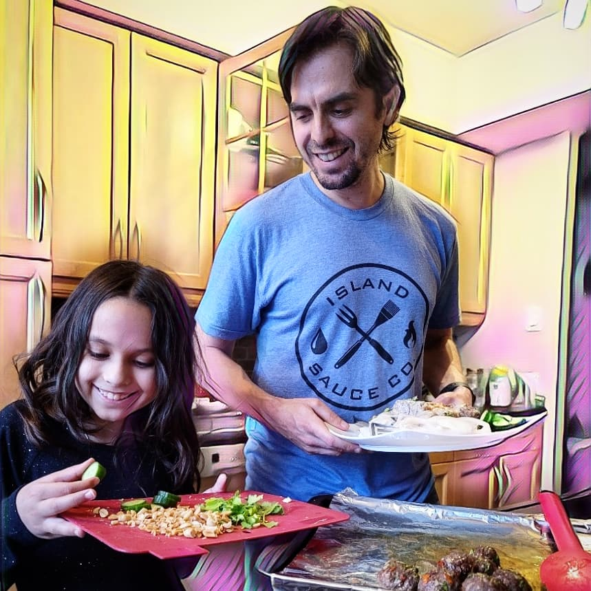 father and daughter smiling and cook it