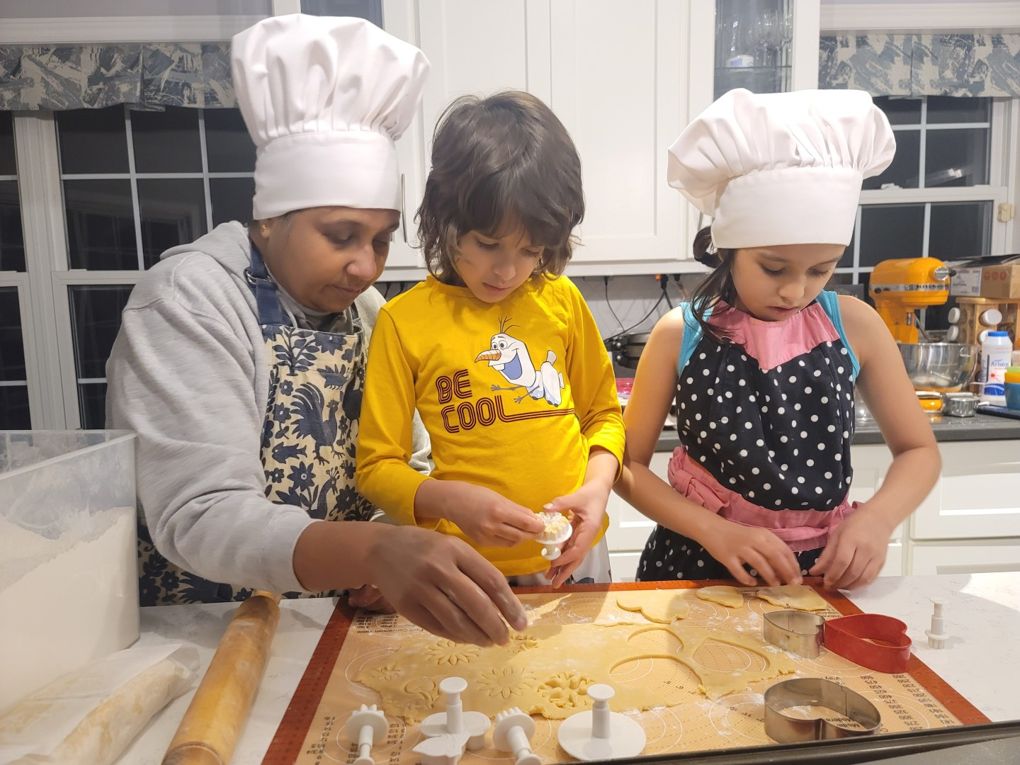 kids and grandmother cooking in kitchen