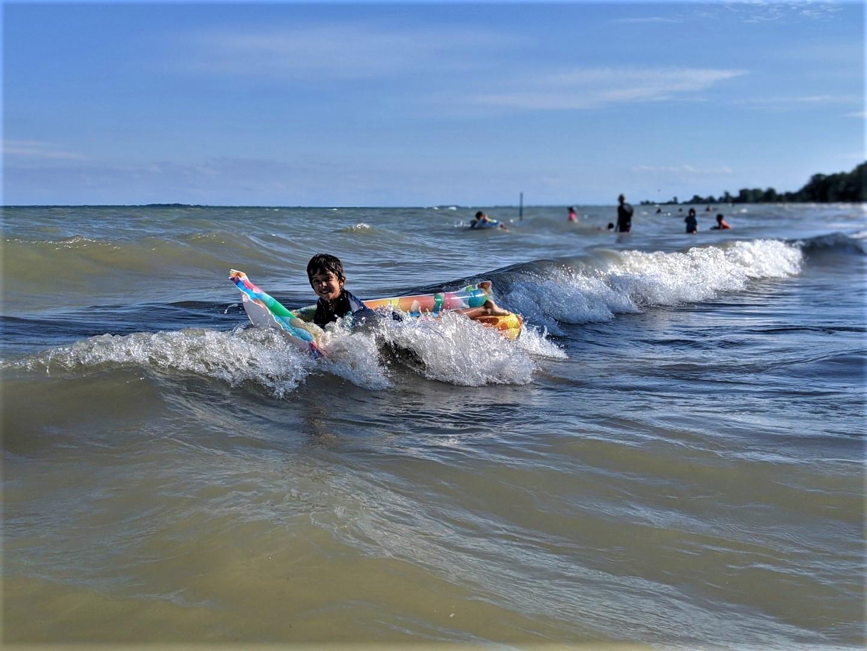 boy in water at Turkey Point Beach in Ontario