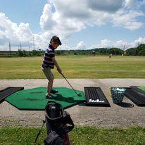 boy golfing in burlington
