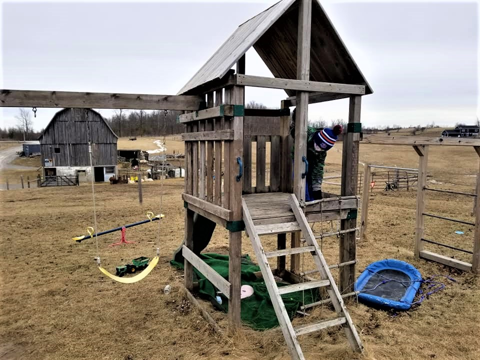 children's playground in Ontario with swing