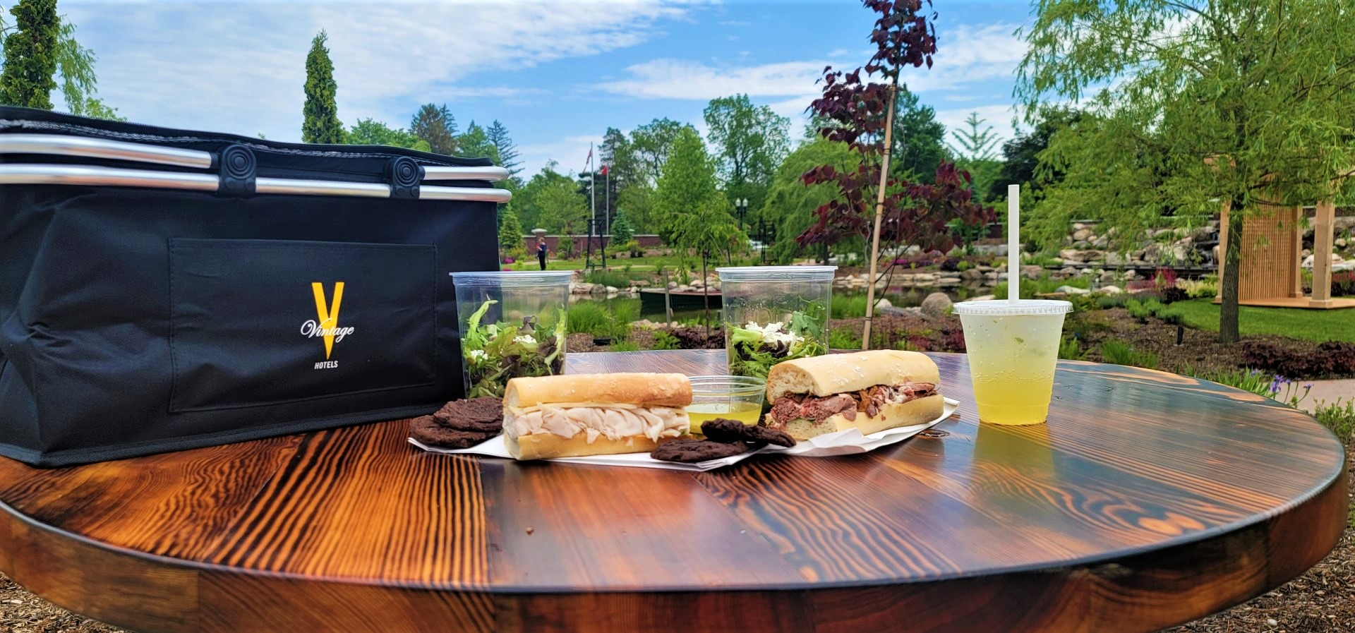 picnic basket and food with a view