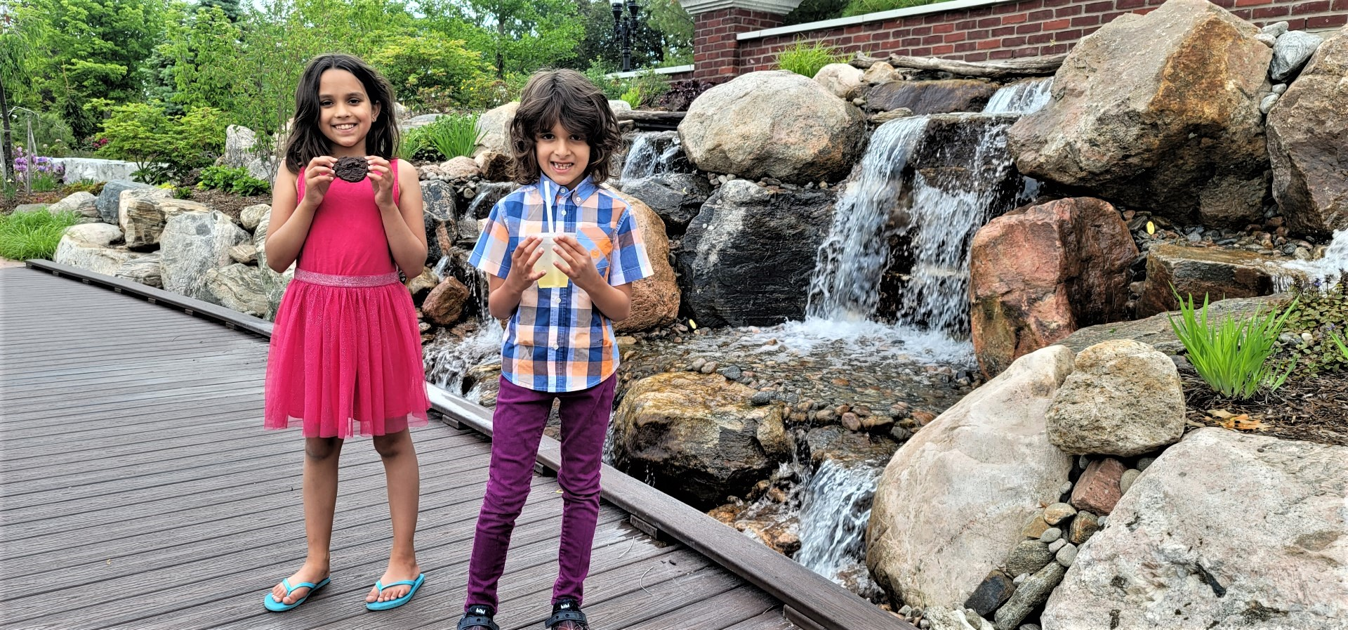 kids holding cookies and drinks at waterfall in Niagara on the Lake