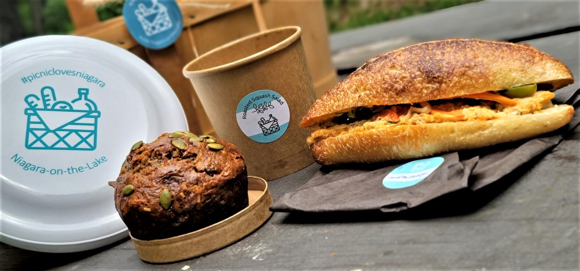 muffin, banh mi, frisbee on a picnic table