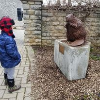 Boy in front of statue at Fergus Garden