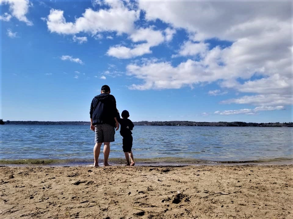 Father and son at sandy Ontario beach