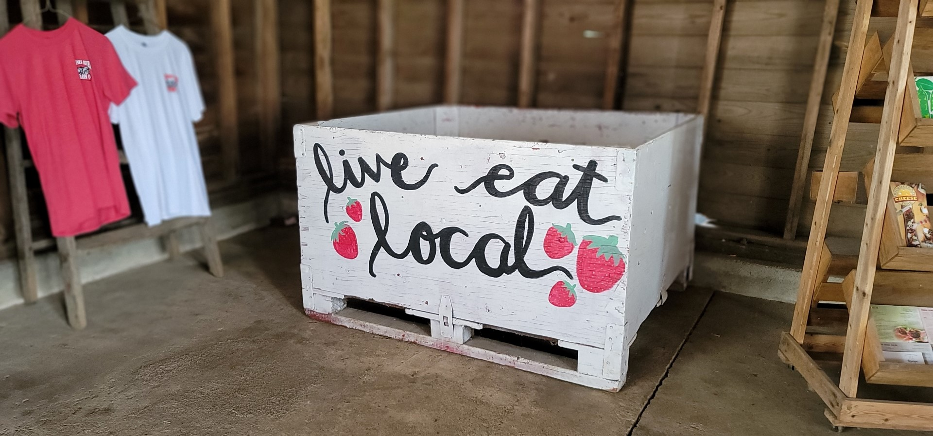 large white box with live eat local