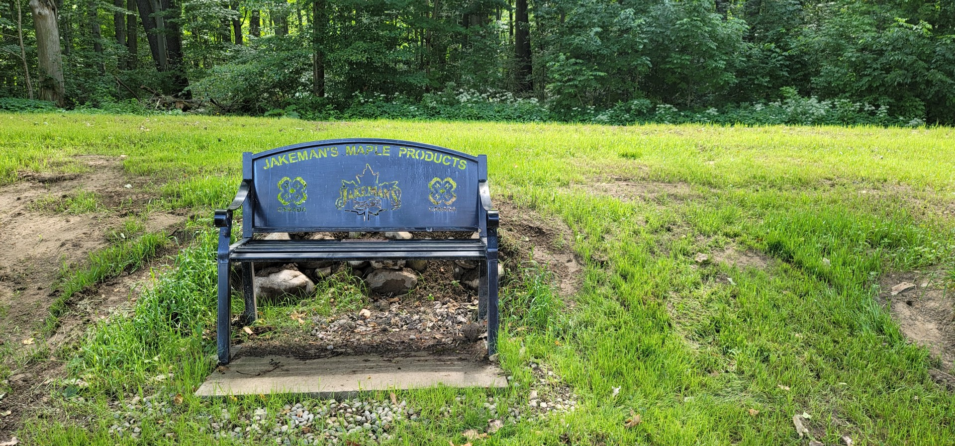 Jakeman's Maple Products engraved on black bench