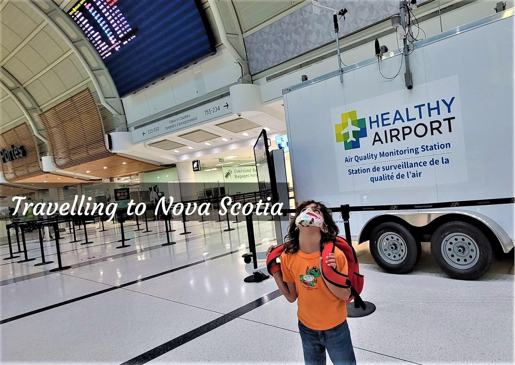 masked child at airport air quality testing unit