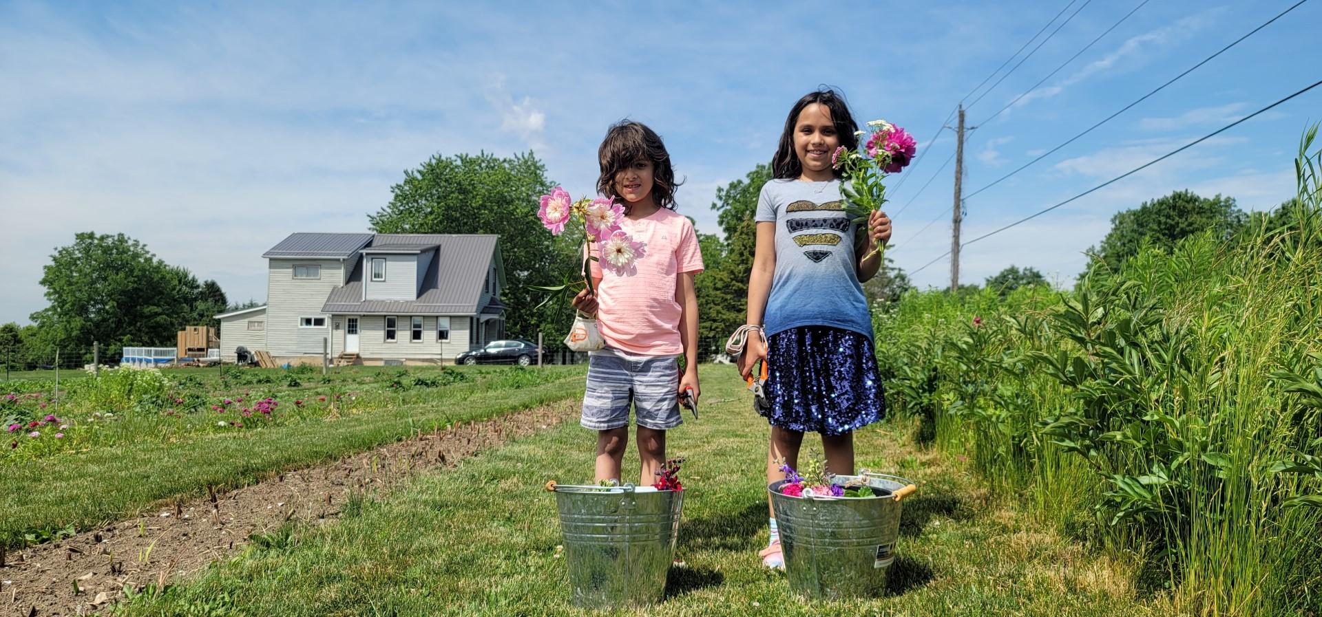 Kids holding flowers