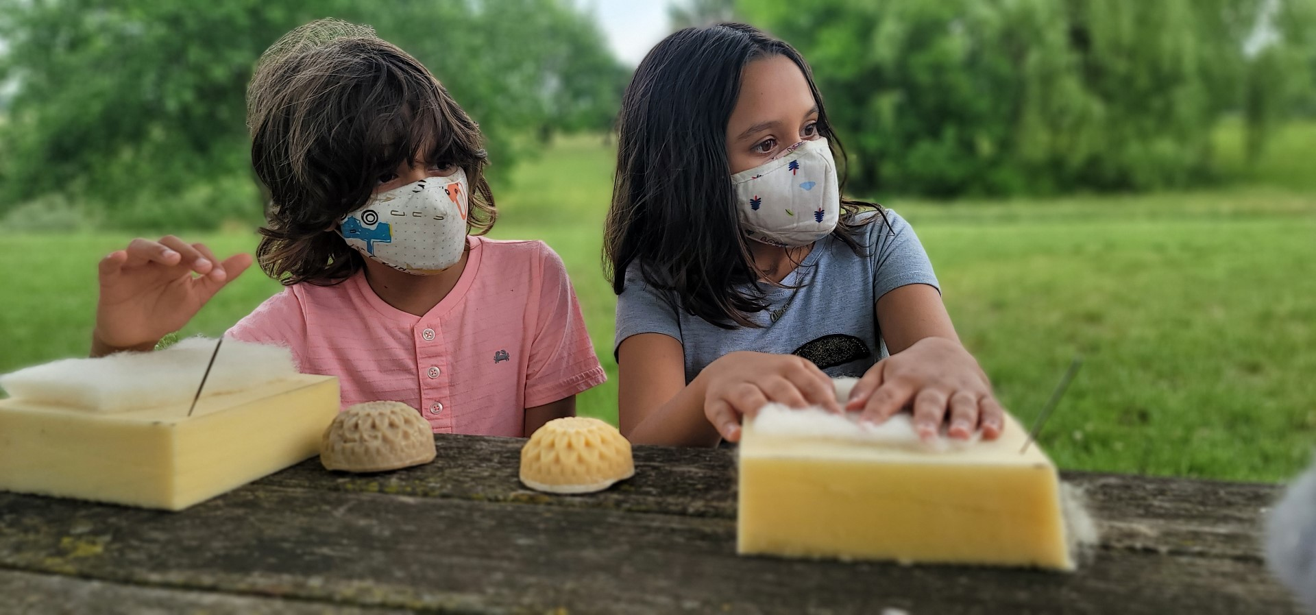Masked kids in front of foam