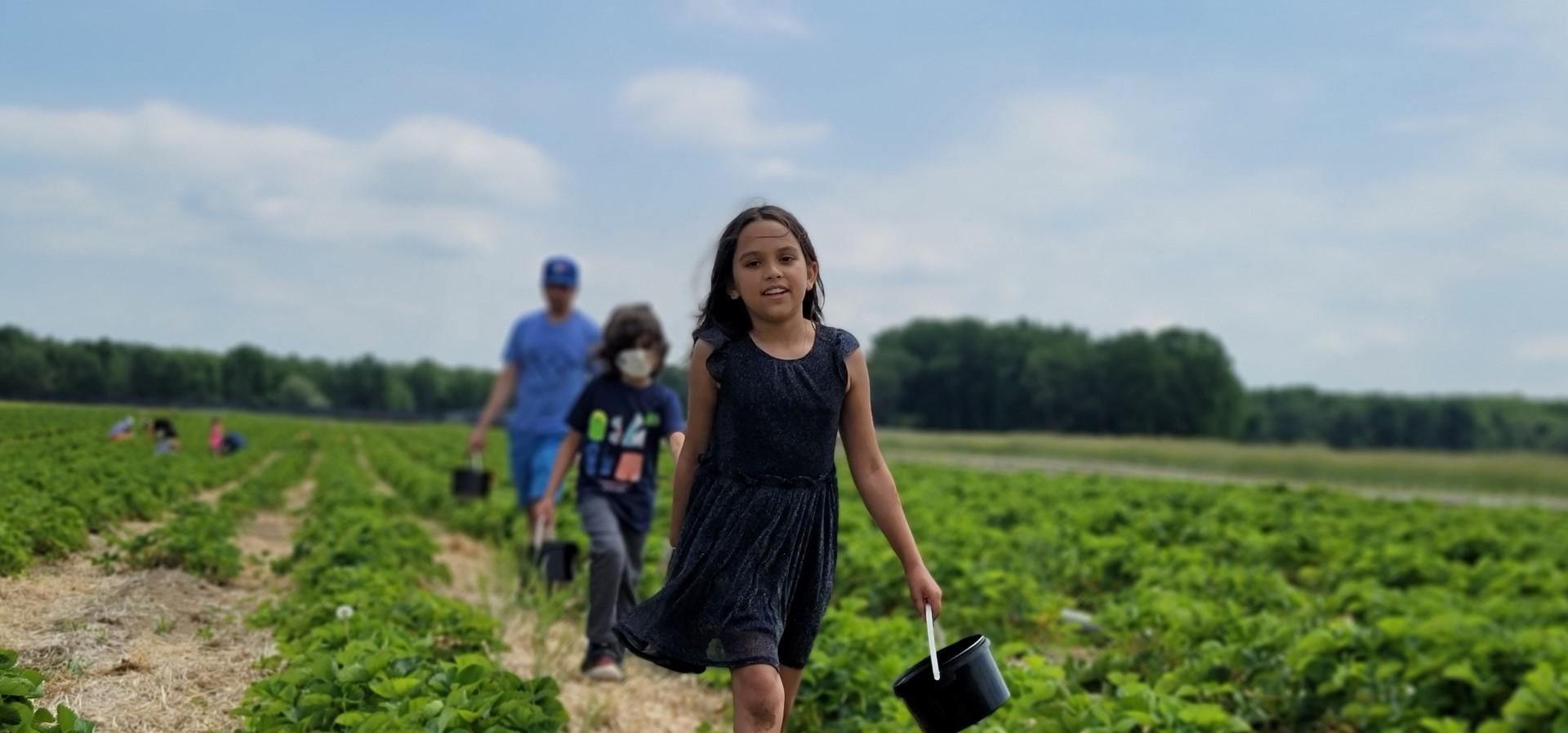 family walking through pick your own farm in Ontario