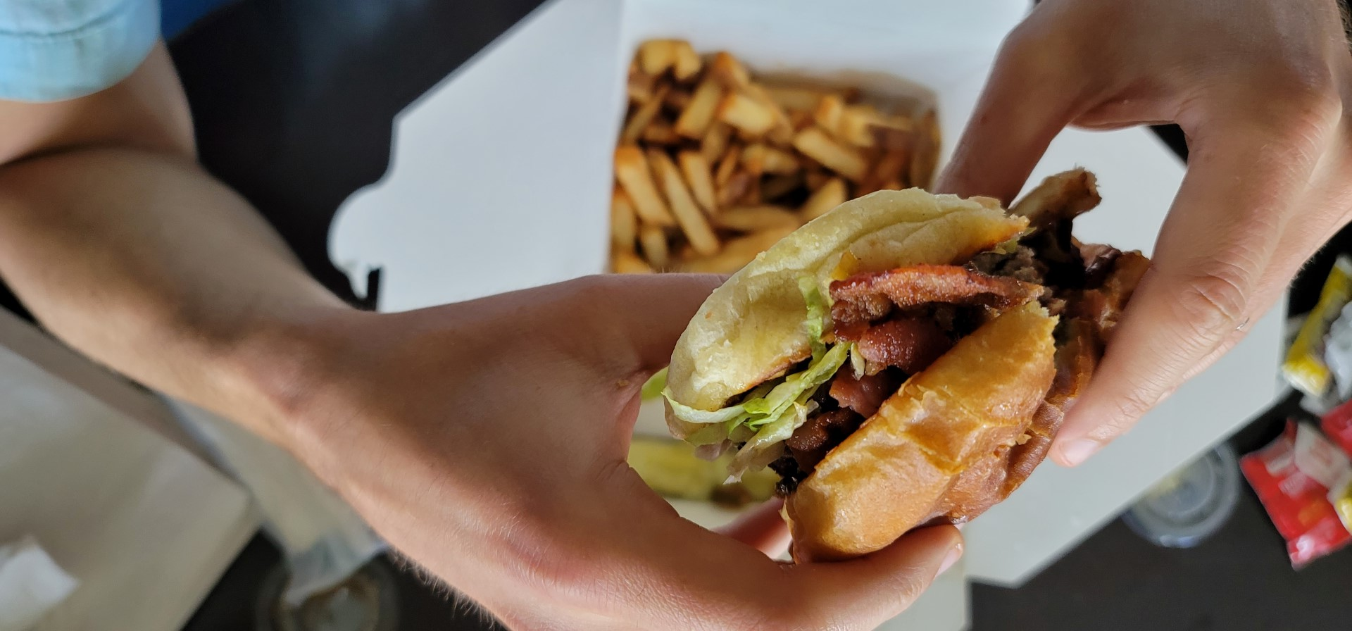hands holding burger