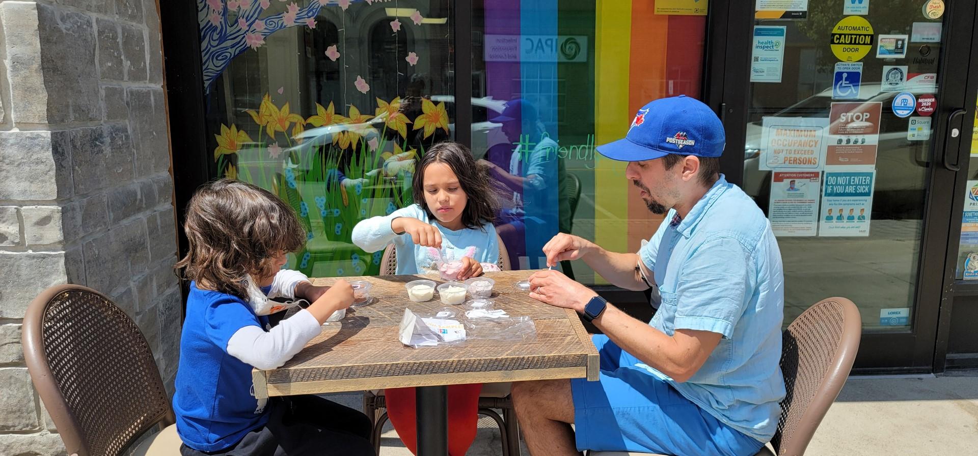 kids and dad enjoying ice cream
