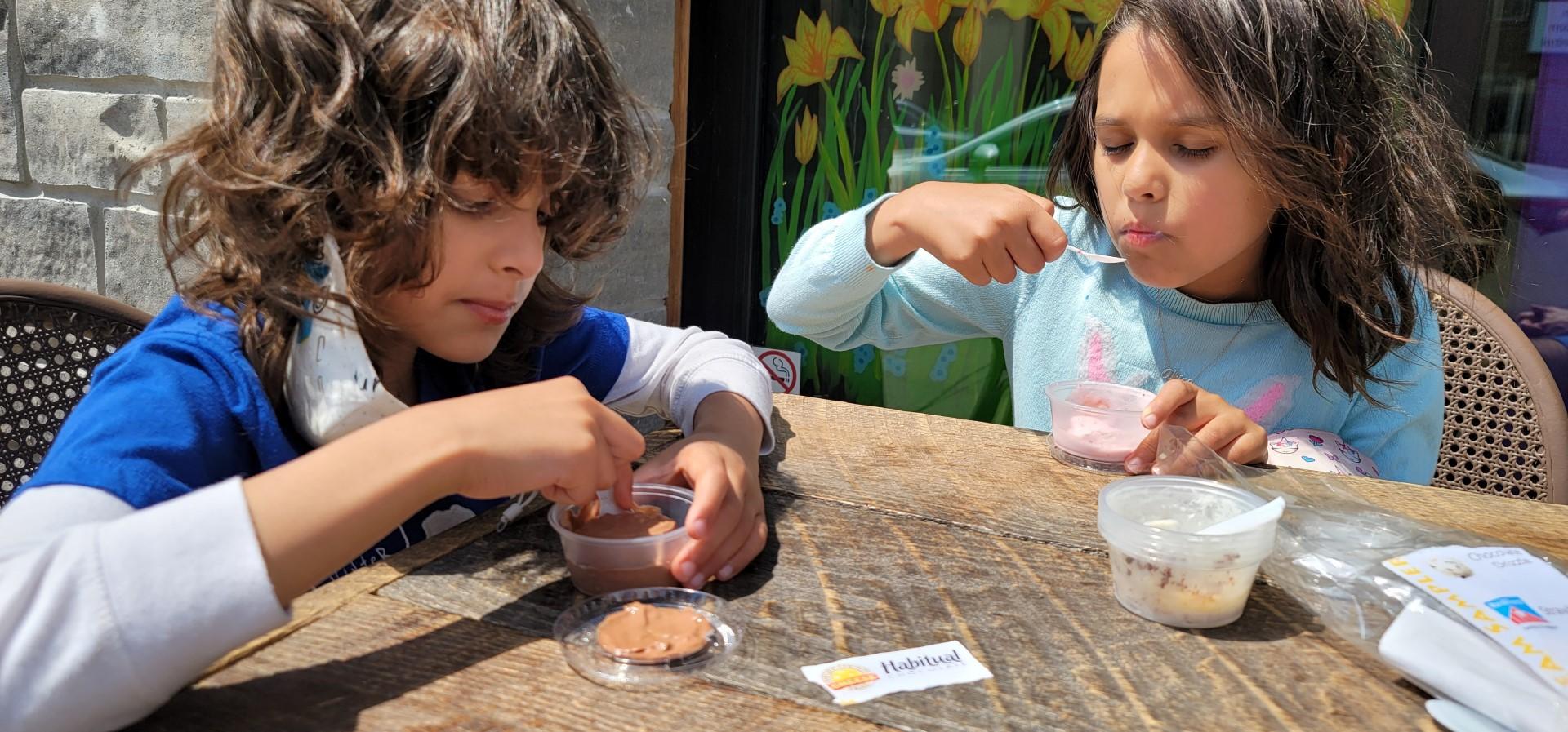 children eating ice cream outdoors