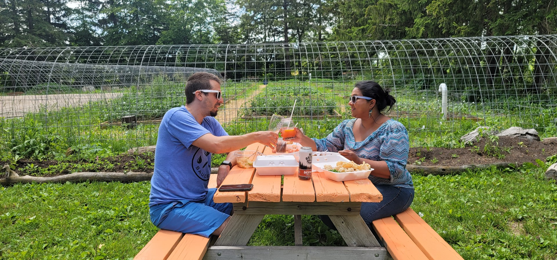 mixed couple enjoying lunch at picnic table