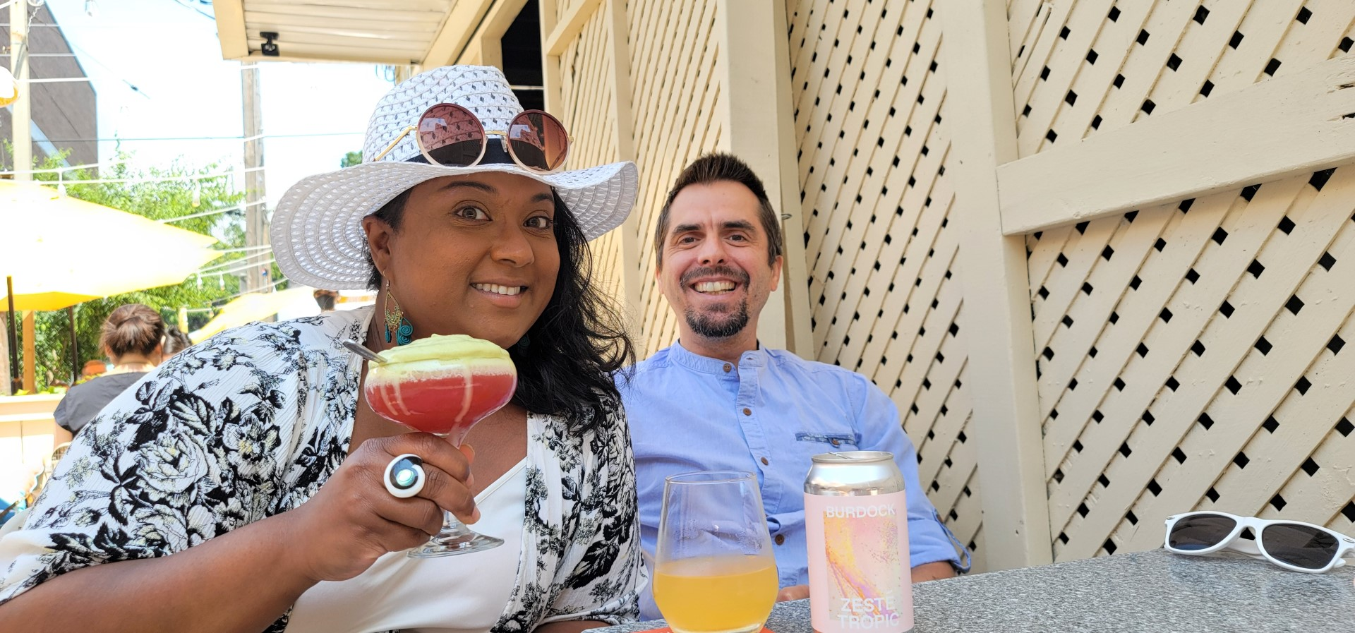 mixed race Toronto couple smiling and holding drinks