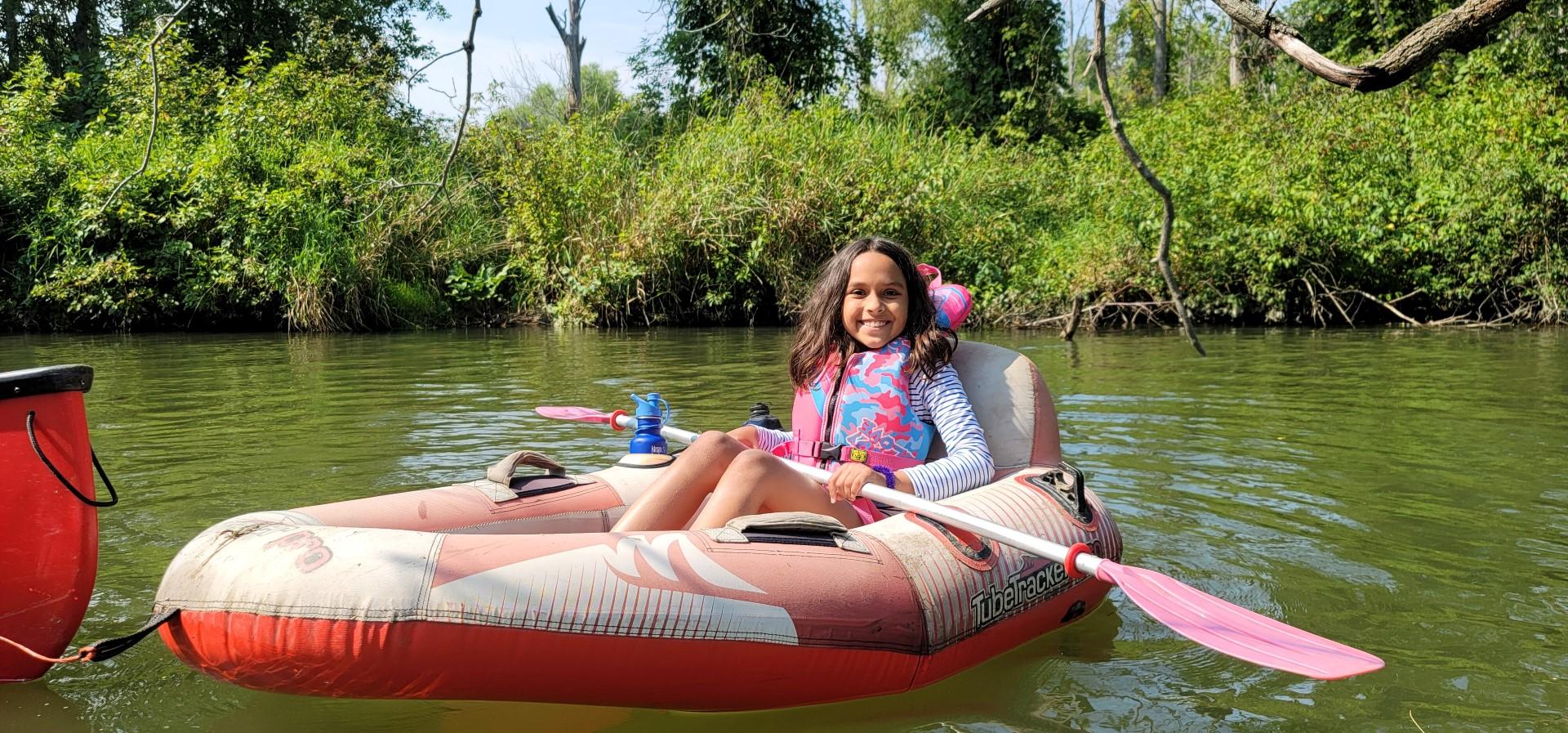 girl smiling in turbo boat in Long Point Ontario