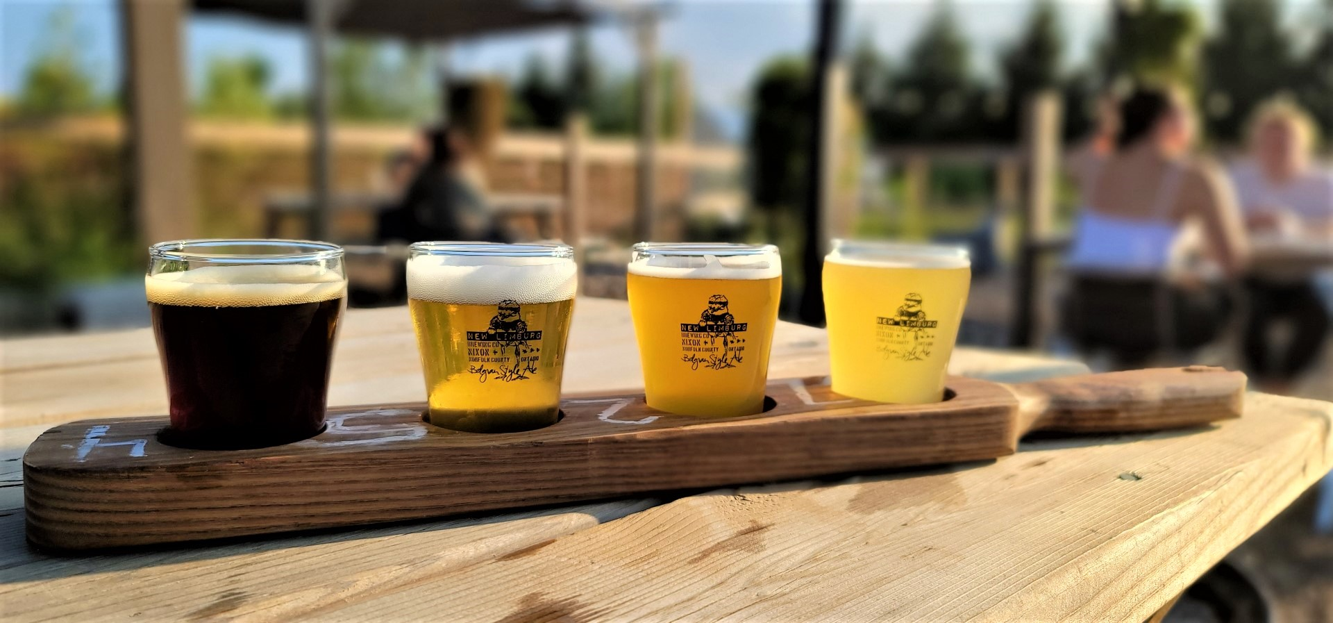 new limburg brewery beer flight on a paddle